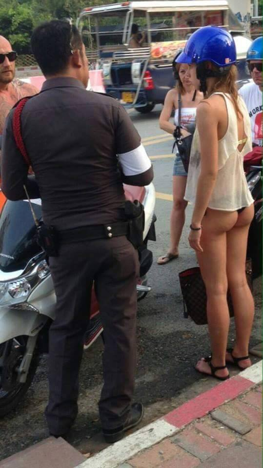 pattaya-farang-girl-fined-motorbike-nude